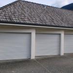 Rolling steel sheet garage doors