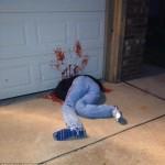 Fake dead body under the garage door