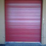 Dark red roll-up door