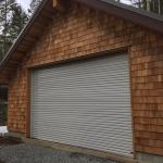 Stone Grey Roll-up Door on Wooden Shop