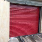 Dark red roll up door