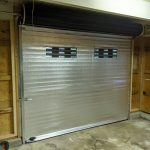 Insulated roll up door with windows
